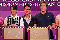 HAIKOU, CHINA - OCTOBER 28:  Hollywood actor Hugh Grant (R) of Great Britain and Hong Kong singer Aaron Kwok (L) pose with their handprints near Dr. Ken Chu (L), Vice Chairman of Mission Hills Group and during a press conference as part of the Mission Hills Star Trophy on October 28, 2010 in Haikou, China. The Mission Hills Star Trophy is Asia's leading leisure liflestyle event and features Hollywood celebrities and international golf stars.  Photo by Victor Fraile / studioEAST