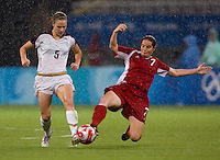 USWNT midfielder (5) Lindsay Tarpley has the ball tackled away from her by Canadian midfielder (7) Rhian Wilkinson while playing at Shanghai Stadium.  The US defeated Canada, 2-1, in extra time and advanced to the semifinals during the 2008 Beijing Olympics in Shanghai, China.