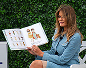 "First lady Melania Trump reads ""The Wonderful Things You Will Be"" by Emily Winfield Martin as she and United States President Donald J. Trump participate in the White House Easter Egg Roll on the South Lawn of the White House in Washington, DC on April 22, 2019.  The White House Easter Egg Roll is a tradition that dates from 1878 and the presidency of US President Rutherford B. Hayes.<br /> Credit: Ron Sachs / CNP<br /> (RESTRICTION: NO New York or New Jersey Newspapers or newspapers within a 75 mile radius of New York City)"