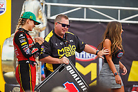 Aug 20, 2017; Brainerd, MN, USA; NHRA top fuel driver Leah Pritchett with Mello Yello entertainer Jason Logan during the Lucas Oil Nationals at Brainerd International Raceway. Mandatory Credit: Mark J. Rebilas-USA TODAY Sports