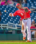 19 September 2015: Washington Nationals third baseman Yunel Escobar warms up prior to a game against the Miami Marlins at Nationals Park in Washington, DC. The Nationals defeated the Marlins 5-2 in the third game of their 4-game series. Mandatory Credit: Ed Wolfstein Photo *** RAW (NEF) Image File Available ***