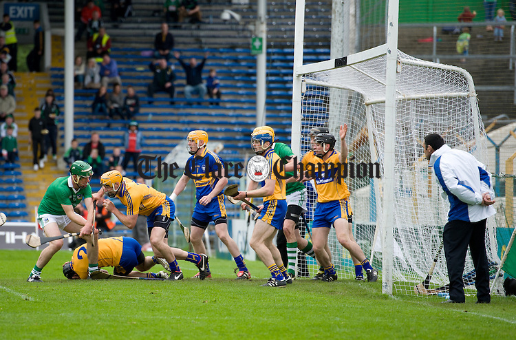Clare's Domhnall O Donovan goes down holding his head after blocking a  Limerick free during their game at Semple Stadium. Photograph by John Kelly.