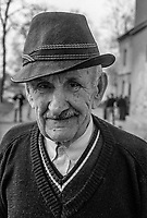 An elderly Bosnian man at the Varazdin refugee camp in the winter of 1992. <br /> <br /> In 1992 while volunteering at the Varazdin refugee camp Panos photographer Bjoern Steinz met and became close to Elvis, a Bosnian Muslim refugee, and his family. They shared the hardships of camp life together which Steinz documented. While the prints were archived for many years two of the images always returned to Bjoern's thoughts. 25 years later he set out to try and find out what had happened to Elvis and his family in the intervening years. Modern social media made the task surprisingly easy and they were reunited in Hadzici where Elvis now lives with his family.