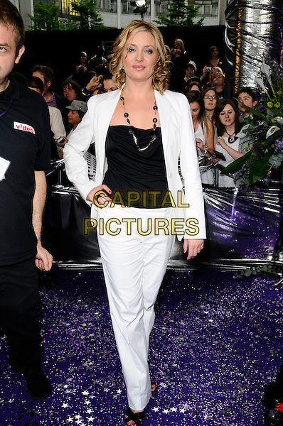 LAURIE BRETT.of Eastenders.Attending the British Soap Awards 2008.BBC Television Centre, Wood Lane, London, England, 3rd May 2008.full length white jacket trousers hand on hip black top suit .CAP/CAN.© Can Nguyen/Capital Pictures