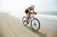 13 JUL 2013 - DEN HAAG, NED - Bastian Dobrowald (GER) of Germany races along the beach during the bike at the 2013 ITU Elite Cross Triathlon World Championships in Kijkduin in Den Haag (The Hague), the Netherlands (PHOTO COPYRIGHT © 2013 NIGEL FARROW, ALL RIGHTS RESERVED)