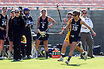 Los Angeles, CA 02/09/13 - Gabriella Flibotte  (Northwestern #19) and Haleigh Dalmass (USC #8) in action during the Northwestern vs USC NCAA Women Lacrosse game at the Los Angeles Colliseum.