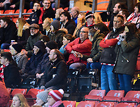 Lincoln City fans watch their team in action<br /> <br /> Photographer Andrew Vaughan/CameraSport<br /> <br /> The EFL Checkatrade Trophy Northern Group H - Lincoln City v Wolverhampton Wanderers U21 - Tuesday 6th November 2018 - Sincil Bank - Lincoln<br />  <br /> World Copyright © 2018 CameraSport. All rights reserved. 43 Linden Ave. Countesthorpe. Leicester. England. LE8 5PG - Tel: +44 (0) 116 277 4147 - admin@camerasport.com - www.camerasport.com
