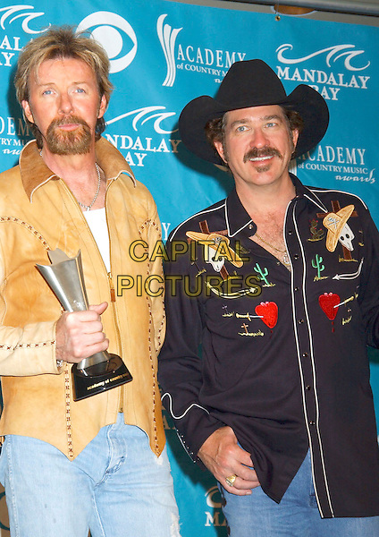 "RONNIE DUNN & KIX BROOKS OF ""BROOKS & DUNN"".Pressroom at the 40th Annual Academy of Country Music Awards (ACM) held at Mandalay Bay Resort & Casino, Las Vegas, Nevada, USA, 17 May 2005..half length cowboy hat award trophy .Ref: ADM.www.capitalpictures.com.sales@capitalpictures.com.©Laura Farr/AdMedia/Capital Pictures."