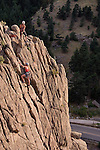 Women rock climbing on the Elephant Buttress rock formation in Boulder Canyon, Boulder, Colorado. .  John leads private photo tours in Boulder and throughout Colorado. Year-round.
