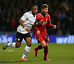 Neil Dansn of Bolton tussles with Adam Lallana of Liverpool - FA Cup Fourth Round replay - Bolton Wanderers vs Liverpool - Macron Stadium  - Bolton - England - 4th February 2015 - Picture Simon Bellis/Sportimage