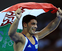 Esultanza di Andrea Minguzzi dopo la conquista della medaglia d'oro con la bandiera<br /> Wrestling - Men's Graco-Roman 84Kg - Lotta Greco Romana<br /> China Agricultural University of Gym<br /> Pechino - Beijing 14/8/2008 Olimpiadi 2008 Olympic Games<br /> Foto Andrea Staccioli Insidefoto