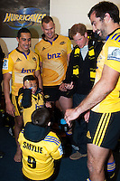 Prince Harry meets Chris Smylie's (left) kids, Noah and Eli (bottom), along with James Broadhurst (back centre) and Hurricanes captain Conrad Smith (right) in the Hurricanes changing rooms after the Super Rugby match between the Hurricanes and Sharks at Westpac Stadium, Wellington, New Zealand on Saturday, 9 May 2015. Photo: Dave Lintott / lintottphoto.co.nz
