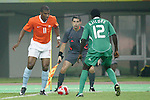 07 August 2008: Ryan Babel (NED) (11) looks to play the ball out of the corner against Ebenezer Ajilore (NGA) (12).  The men's Olympic soccer team of the Netherlands played the men's Olympic soccer team of Nigeria at Tianjin Olympic Center Stadium in Tianjin, China in a Group B round-robin match in the Men's Olympic Football competition.