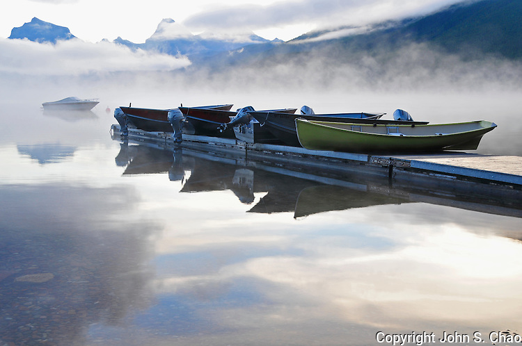 Lake McDonald boat dock in mist at sunrise, Glacier National Park, Montana.