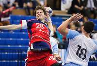 05 APR 2012 - LONDON, GBR - Great Britain's Gawain Vincent (GBR) (left, #28, in red and blue) shoots during the men's 2012 London Cup match against Argentina at the National Sports Centre in Crystal Palace, Great Britain (PHOTO (C) 2012 NIGEL FARROW)