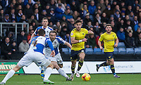 George Baldock of Oxford United heads forward under pressure from Stuart Sinclair of Bristol Rovers during the Sky Bet League 2 match between Oxford United and Bristol Rovers at the Kassam Stadium, Oxford, England on 17 January 2016. Photo by Andy Rowland / PRiME Media Images.