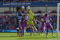 Goalkeeper Luke McCormick of Plymouth Argyle punches clear of danger during the Sky Bet League 2 match between Wycombe Wanderers and Plymouth Argyle at Adams Park, High Wycombe, England on 12 September 2015. Photo by Andy Rowland.