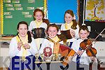 SCOR NA BPAISTI: The Ballymac Football musicians who won the Castleisland Scor na bPaisti district final and overall club winner's seated l-r: Claire Kenny, Therese Keane and Darragh Lynch. Back l-r: Laura Daly and Ailbhe Ryle.