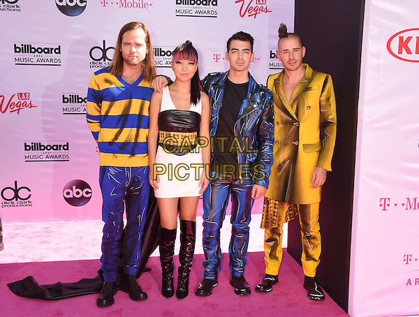 LAS VEGAS, NV - MAY 22: (L-R) Musicians Jack Lawless, JinJoo Lee, Joe Jonas and  Cole Whittle of DNCE attend the 2016 Billboard Music Awards at T-Mobile Arena on May 22, 2016 in Las Vegas, Nevada.<br /> CAP/ROT/TM<br /> &copy;TM/ROT/Capital Pictures