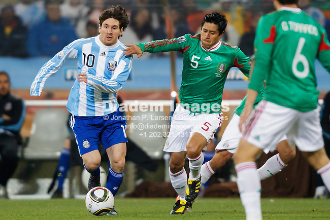 JOHANNESBURG, SOUTH AFRICA - JUNE 27:  Lionel Messi of Argentina (10) looks for space against Ricardo Osorio of Mexico (5) during the FIFA World Cup round of 16 match at Soccer City Stadium on June 27, 2010 in Johannesburg, South Africa.  Editorial use only.  Commercial use prohibited.  No push to mobile device usage.  (Photograph by Jonathan Paul Larsen)