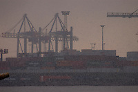 Hamburg cranes and containers in a snow flurry,river Elbe Hamburg, Germany