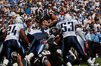 Sept. 17, 2006; San Diego, CA, USA; San Diego Chargers quarterback (17) Phillip Rivers leaps over defenders for a first down against the Tennessee Titans at Qualcomm Stadium in San Diego, CA. Mandatory Credit: Mark J. Rebilas