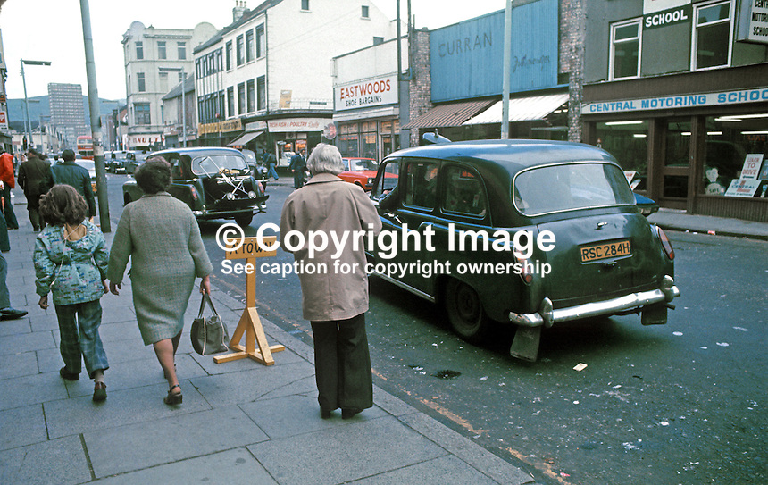 Black taxis, Castle Street, Belfast, N Ireland, July, 1977, 197707000085b..Copyright Image from Victor Patterson, 54 Dorchester Park, Belfast, United Kingdom, UK...For my Terms and Conditions of Use go to http://www.victorpatterson.com/Victor_Patterson/Terms_%26_Conditions.html