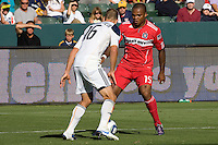 Collins John of Chicago Fire attempts to move past Gregg Berhalter of the LA Galaxy. The Chicago Fire beat the LA Galaxy 3-2 at Home Depot Center stadium in Carson, California on Sunday August 1, 2010.