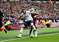 23rd November 2019; London Stadium, London, England; English Premier League Football, West Ham United versus Tottenham Hotspur; Ryan Fredericks of West Ham United challenges Eric Dier of Tottenham Hotspur - Strictly Editorial Use Only. No use with unauthorized audio, video, data, fixture lists, club/league logos or 'live' services. Online in-match use limited to 120 images, no video emulation. No use in betting, games or single club/league/player publications