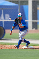 Toronto Blue Jays first baseman Chris Bec (25) waits to receive a throw during a Florida Instructional League game against the Pittsburgh Pirates on September 20, 2018 at the Englebert Complex in Dunedin, Florida.  (Mike Janes/Four Seam Images)