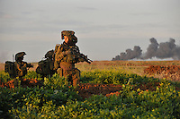 Israeli infantry soldiers enter Gaza. Israeli forces began an air offensive against Hamas in Gaza on 27/12/2008, which quickly escalated into an offensive by land, sea and air, in retaliation against Palestinian rockets fired into Israel. After eight days of bombardment, leaving over 400 Palestinians and four Israelis dead, Israeli tanks entered Gaza on 04/01/2009...