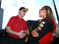 Sep 5, 2016; Clermont, IN, USA; NHRA top fuel driver Leah Pritchett (right) talks with NHRA president Peter Clifford during the US Nationals at Lucas Oil Raceway. Mandatory Credit: Mark J. Rebilas-USA TODAY Sports