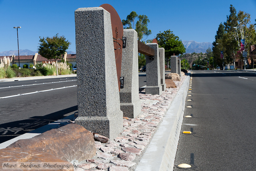 """The rocks and iron plate windmilll cutouts of the northern median.  This was part of the 2015 rebuild of the Grand Avenue and Diamond Bar Boulevard intersection for Diamond Bar's 2015 """"Grand Avenue Beautification"""" project, landscape architecture for the project was by David Volz Design."""