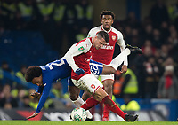 Granit Xhaka of Arsenal fouls Willian of Chelsea during the Carabao Cup semi final 1st leg match between Chelsea and Arsenal at Stamford Bridge, London, England on 10 January 2018. Photo by Andy Rowland.