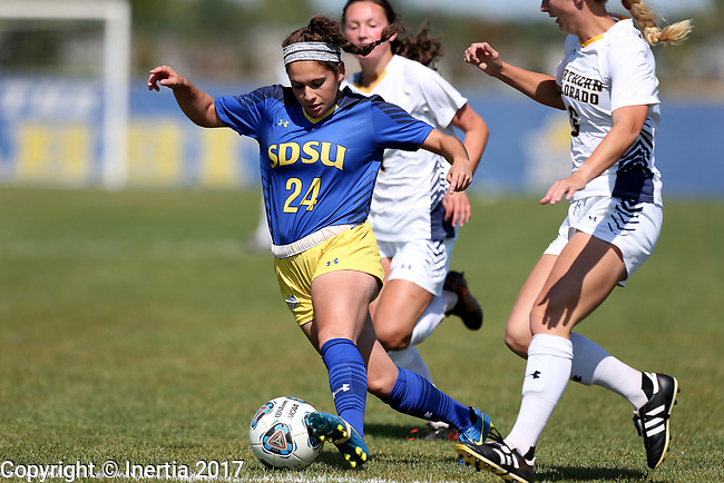 BROOKINGS, SD - SEPTEMBER 17:  Bianca Madonia #24 from South Dakota State University controls the ball in front of a pair of defenders including Courtney Elterman #5 from Northern Colorado during their game Sunday afternoon at Fischback Soccer Field in Brookings. (Photo by Dave Eggen/Inertia)