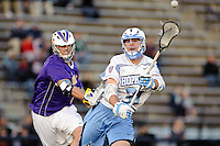 Baltimore, MD - April 5: Midfielder John Ranagan #31 of the John Hopkins Blue Jays passes to a teammate  during the Albany v Johns Hopkins mens lacrosse game at  Homewood Field on April 5, 2012 in Baltimore, MD. (Ryan Lasek/Eclipse Sportwire)