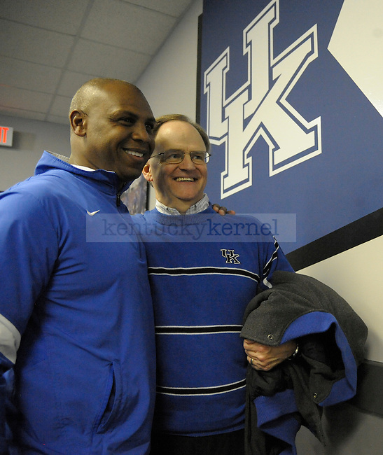 Kentucky Wildcats head coach Joker Phillips is congratulated by former University of Kentucky President Lee Todd after the press conference of University of Kentucky football game against Tennessee at Commonwealth Stadium in Lexington, Ky., on 11/26/11. Uk won the game 10-7. Photo by Mike Weaver | Staff