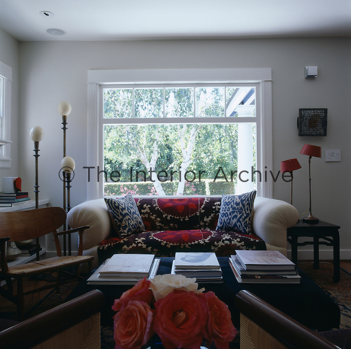 The living room sits at the front of the house and has a view onto the front garden and leafy street beyond