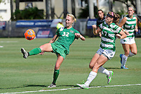 8 November 2015:  Marshall Forward Erin Simmons (32) attempt to shoot a goal while North Texas Defender Tess Graham (7) looks on in the first half as the Marshall University Thundering Herd faced the University of North Texas Mean Green in the Conference USA championship game at University Park Stadium in Miami, Florida.