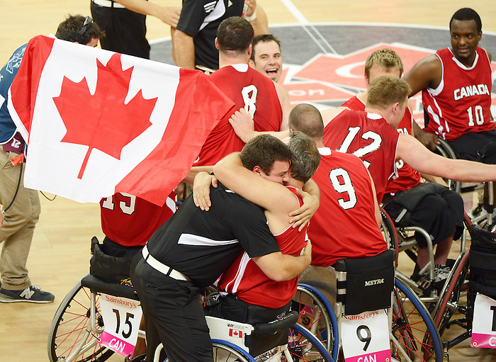 LONDON, ENGLAND 09/08/2012 Team Canada reacts after winning the Gold Medal in the Men's Wheelchair Basketball against Team Australia at the  London 2012 Paralympic Games at the North Greenwich Arena.  (Photo by Matthew Murnaghan/Canadian Paralympic Committee)