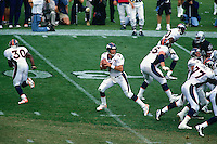 OAKLAND, CA - Quarterback John Elway of the Denver Broncos in action during a game against the Oakland Raiders at the Oakland Coliseum in Oakland, California in 1997. Photo by Brad Mangin