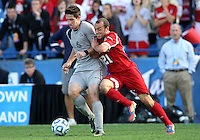 HOOVER, AL - DECEMBER 09, 2012: Kyle Sparks (21) of Indiana Universityleans into Jimmy Nealis (16) of Georgetown University during the NCAA 2012 Men's College Cup championship, at Regions Park, in Hoover , AL, on Sunday, December 09, 2012.