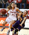 VERMILLION, SD - MARCH 24, 2016 -- Tia Hemiller #4 of South Dakota drives past a fallen Madison Weekly #2 of Northern Iowa during their WNIT game Thursday evening at the Dakotadome in Vermillion, S.D.  (Photo by Dick Carlson/Inertia)