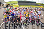 Coars Foilmore NS pupils took part in the National Bike week Safety Skills training day at Foilmore GAA on Monday pictured her with, front centre Eamon Casey(Casey Cycles) & Dan Ahern(Killorglin Cycling Club) were pupils, teachers and parents.  All the participants received  HI-Vis Jacket, Rug Sack Cover & Road Safety Booklet for taking part in the course.
