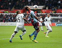 Sunday, 26 April 2014<br /> Pictured L-R: Wayne Routledge of Swansea against Gabriel Agbonlahor of Aston Villa.<br /> Re: Barclay's Premier League, Swansea City FC v Aston Villa at the Liberty Stadium, south Wales.