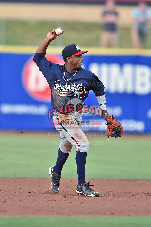 Mississippi Braves second baseman Ozzie Albies (20) throws to first base during a game against the Tennessee Smokies at Smokies Stadium on July 23, 2016 in Kodak, Tennessee. The Braves defeated the Smokies 3-0. (Tony Farlow/Four Seam Images)