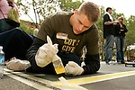 Cole Aldrich paints a line on a basketball court in New York City as part of his volunteer service on August 31, 2006.  The players were in town for the Elite 24 Hoops Classic, which brought together the top 24 high school basketball players in the country regardless of class or sneaker affiliation.