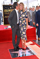 """LOS ANGELES, CA. September 13, 2018: Eric McCormack & Janet Holden at the Hollywood Walk of Fame Star Ceremony honoring """"Will & Grace"""" star Eric McCormack."""