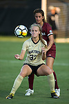 Hannah Betfort (33) of the Wake Forest Demon Deacons uses her body to keep the ball away from Jackie Schaefer (4) of the South Carolina Gamecocks during first half action at Spry Soccer Stadium on August 24, 2017 in Winston-Salem, North Carolina.  The Demon Deacons defeated the Gamecocks 3-2.  (Brian Westerholt/Sports On Film)