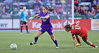 Portland, Oregon - Sunday April 17, 2016: Orlando Pride midfielder/defender Maddy Evans (18) gets past Portland Thorns FC midfielder Tobin Heath (17). The Portland Thorns play the Orlando Pride during a regular season NWSL match at Providence Park.